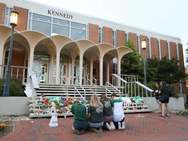 Students and faculty honor the victims of a shooting at the University of North Carolina Charlotte.