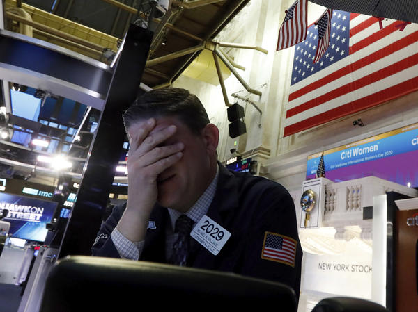 A trader reacts on the floor of the New York Stock Exchange on Monday. The U.S. stock market had its worst day since 2008.