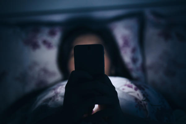 """""""Your brain doesn't distinguish between the work that you do at your job and paging through Facebook while you're in bed,"""" says author Celeste Headlee. """"To your brain, you're still working."""""""