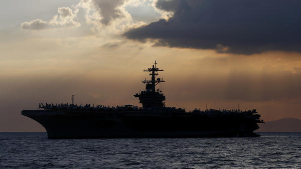 The aircraft carrier USS Theodore Roosevelt anchored off Manila Bay west of Manila, Philippines, in a photo from 2018.