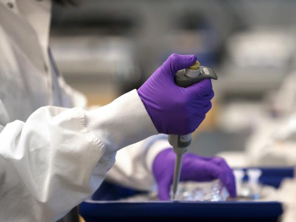 A scientist works in a lab at Moderna in Cambridge, Mass., in February. Moderna has developed an experimental coronavirus medicine, but an approved treatment could be more than a year away.