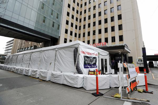A tent stands outside the emergency entrance of Harborview Medical Center in Seattle, on Saturday.