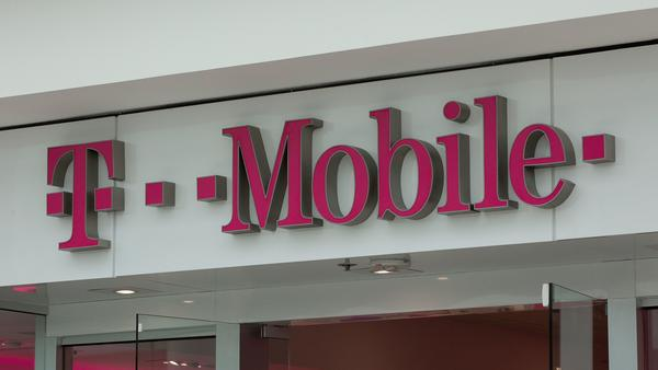 A T-Mobile logo outside a shop in Washington, DC. The company has completed its takeover of rival mobile carrier Sprint.
