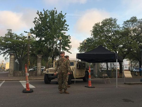 National guard troops stand outside the entrance to Mahalia Jackson theater on the first day of the drive through testing program. That site will be closed. The only site left with be at the UNO Lakefront Arena.