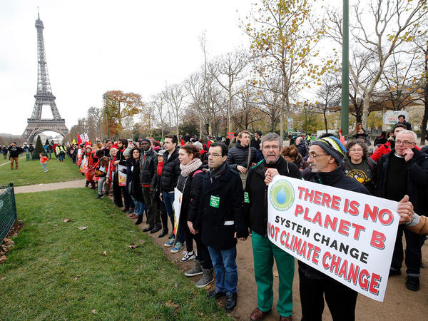 United Nations officials are delaying a climate conference this fall, which many climate activists hoped would the biggest step forward since negotiations in Paris in 2015. Here, activists rally on Dec. 12, 2015.
