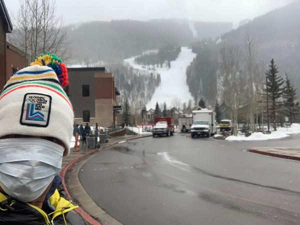Telluride resident Teddy Errico snaps a selfie outside a building where residents had their blood drawn for COVID-19 tests.
