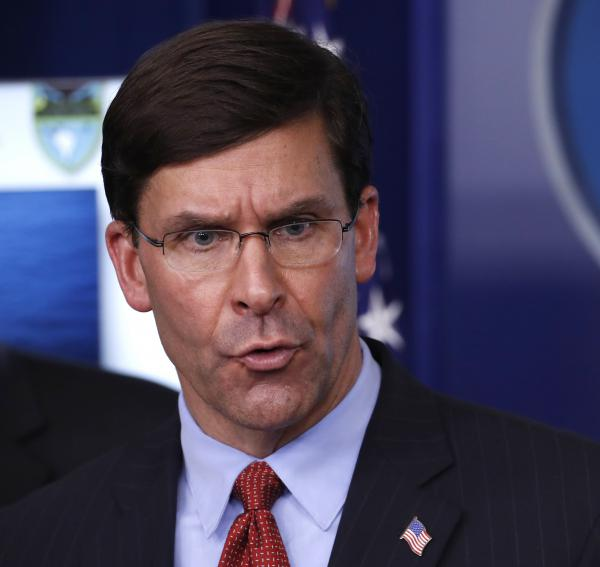 Defense Secretary Mark Esper speaks about the coronavirus in the James Brady Press Briefing Room of the White House on Wednesday.
