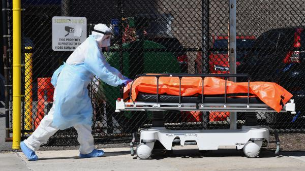Medical staff move bodies from the Wyckoff Heights Medical Center in Brooklyn, N.Y., Thursday to a refrigerated truck.