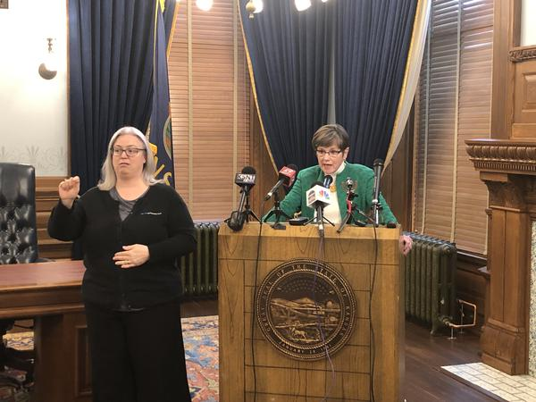 American Sign Language interpreter Allison Gile signs a press conference for Kansas Governor Laura Kelly in March.