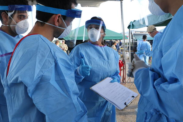 Medical workers review protocol and prepare for a day of coronavirus testing at the drive-through testing site at UNO's Lakefront Arena. April 2, 2020.