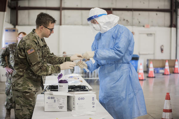 The Illinois National Guard is supporting a drive-up COVID-19 testing site in Bloomington.