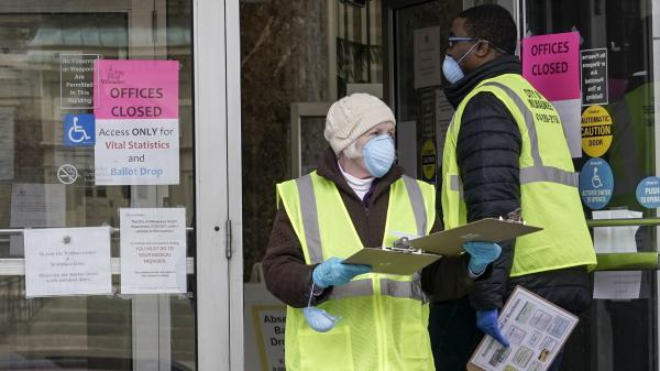 Workers are seen outside a city building in Milwaukee, which set up drive-up early voting for the state's April 7 election in response to the coronavirus outbreak.