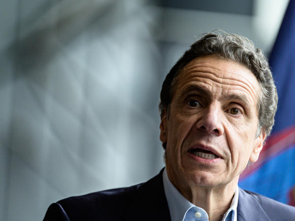 """While none of this is good news, the ... possible flattening of the curve is better than the increases that we have seen,"" New York Gov. Andrew Cuomo said Monday. He is seen last month following the arrival of the U.S. Naval hospital ship Comfort to New York City."