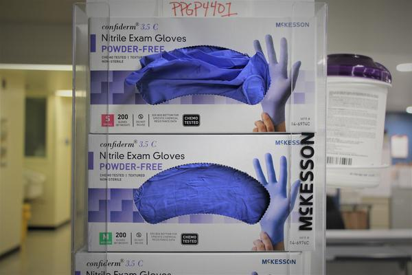 Nitrile gloves are among protective gear in short supply.