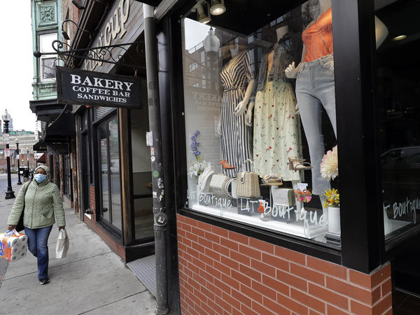 A pedestrian strolls past a boutique in the North End neighborhood of Boston in late March after Massachusetts Gov. Charlie Baker ordered all nonessential businesses to close in an effort to slow down the spread of the coronavirus.