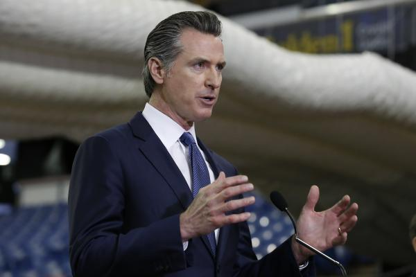 Gov. Gavin Newsom discusses the acquisition of the NBA's Sacramento Kings' former home arena for use as a 400-bed field hospital to help deal with the coronavirus in California's state capital on Monday.
