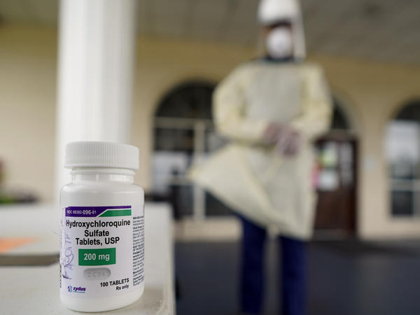A bottle of hydroxycloroquine sits on a table outside the entrance to The Resort at Texas City nursing home, where Robin Armstrong, a doctor and the home's medical director, is giving the drug to COVID-19 residents.