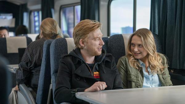 Billy (Domhnall Gleeson) and Ruby (Merritt Wever) get some strange on a train in HBO's spiky romantic comedy <em>Run</em>.