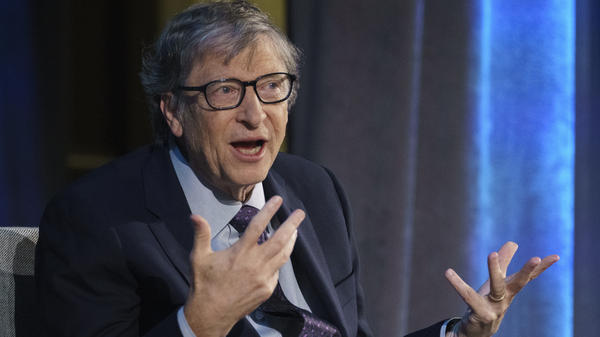 Microsoft co-founder Bill Gates, seen above in 2018, gives high marks for social distancing efforts during the coronavirus pandemic but low marks for testing. He says he thinks large public gatherings may have to wait until there's a vaccine.