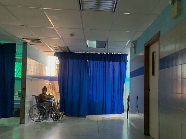 A patient on a wheelchair waits in the emergency room at a hospital in Güiria, Venezuela, on March 14. Human rights organizations recently warned that Venezuela faces catastrophic consequences from the new coronavirus pandemic, which threatens to overwhelm its crumbling health system.