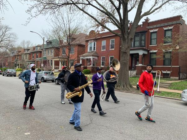 The Red and Black Brass Band march down Juniata Street Sunday afternoon. The group became a viral sensation after a Twitter user uploaded a video online.
