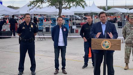 Governor Ron DeSantis (at podium), Jacksonville Mayor Lenny Curry and other officials announced a loosening of restrictions for COVID-19 testing at the TIAA Bank Field site.