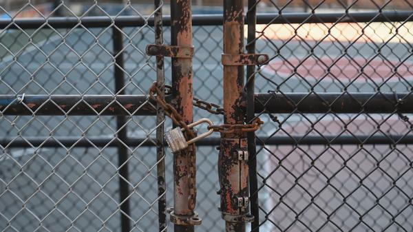 The gate at Public School 39 in Brooklyn has been locked since last month. On Saturday, there were conflicting statements on when or whether the city's schools will reopen for the academic year.