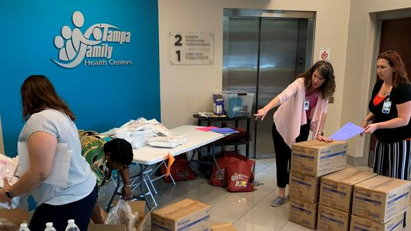 Staff from the Tampa Family Health Centers recently unpacked a shipment of personal protective equipment for its staff.