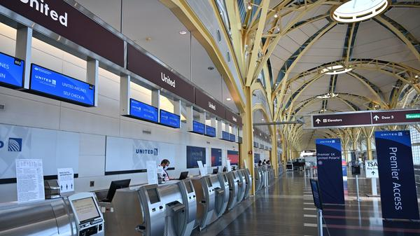 With flight schedules slashed, airline counters at Reagan National Airport are empty. The fallout from the coronavirus will be much worse than during the financial crisis, the International Monetary Fund says.