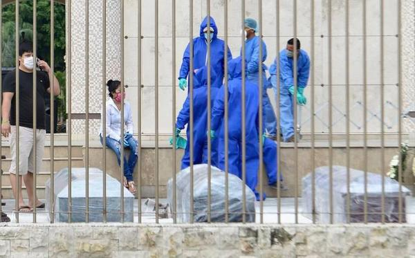 Cemetery workers in Guayaquil, Ecuador, moving corpses of COVID-19 patients from a sidewalk this month.