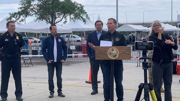 Jacksonville Mayor Lenny Curry speaking at the Lot J COVID-19 testing site on April 10, alongside Gov. Ron DeSantis, DEM Director Jared Moskowitz, and JSO Sheriff Mike Williams.