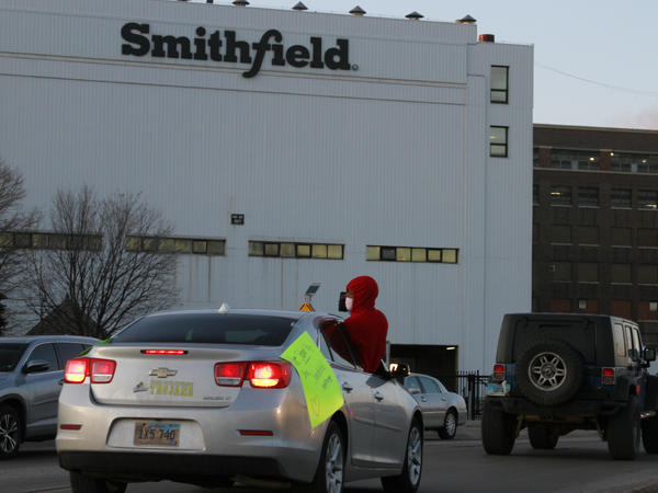Employees and family members protest outside a Smithfield Foods processing plant in Sioux Falls, South Dakota last week. The plant has had an outbreak of coronavirus cases.