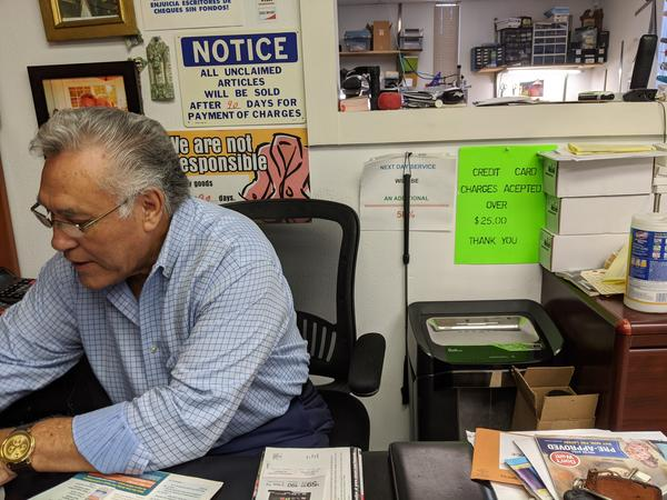 Juan Rios works at his business Chicago Custom Tailor Shop.