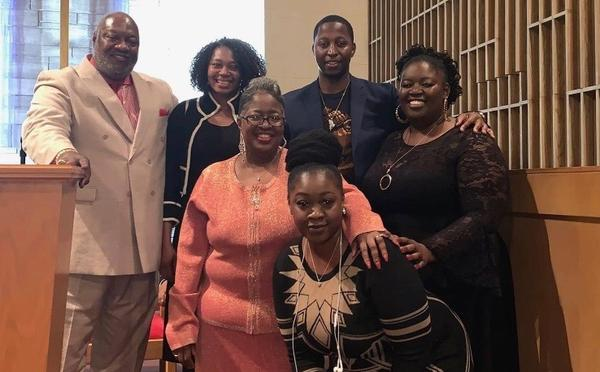 The Smith family gathers at New Beginning Missionary Baptist Church.
