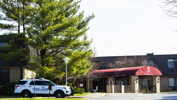 After an anonymous tip to police, 17 people were found dead at the Andover Subacute and Rehabilitation Center. Here, a New Jersey Police vehicle parks at the facility's entrance on Thursday.