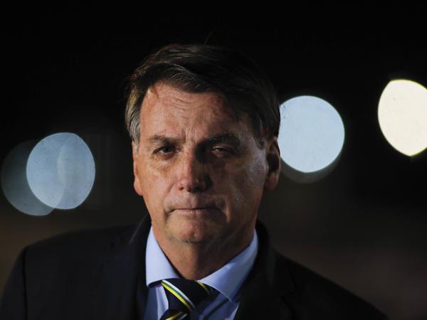 Brazil's President Jair Bolsonaro speaks to reporters in Brasilia on Thursday.