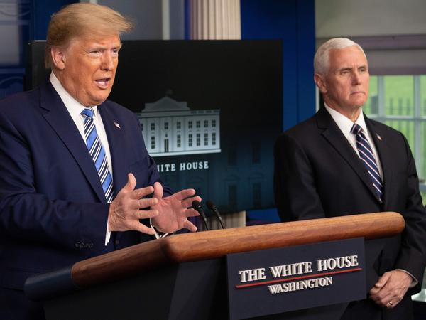 President Trump speaks as Vice President Pence looks on during a coronavirus task force press briefing on Sunday.