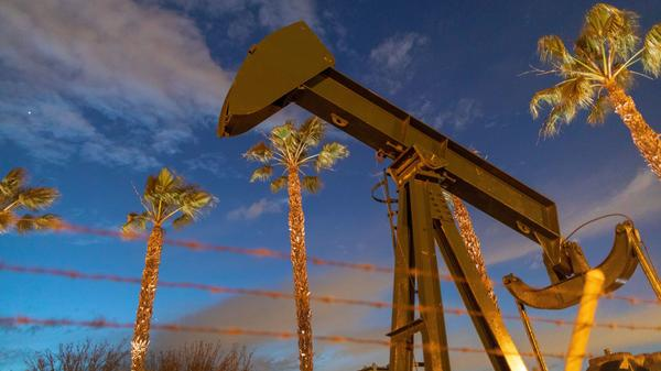 A U.S. crude oil benchmark has hit record lows. Above, pump jacks draw crude oil near Long Beach, Calif., on March 9.