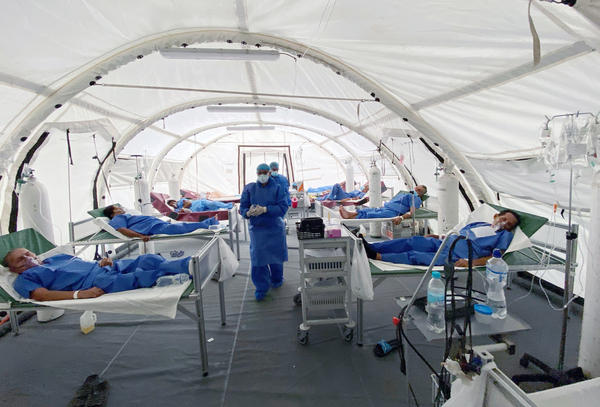 Patients are treated for COVID-19 at a field hospital in Guayaquil, Ecuador.
