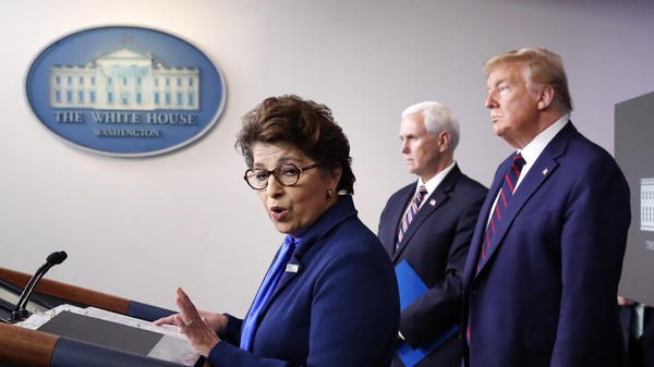 Jovita Carranza, head of the Small Business Administration, addresses the press earlier this month at the White House, as Vice President Pence and President Trump listen.