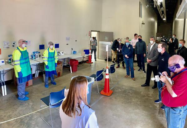 Media and officials tour the new Walgreen's testing facility at 9th and North Grand streets in Springfield.
