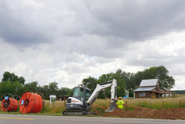 Crews work in July, 2019 to install new fiber to the town of Norwood. While the fiber has reached the public library, librarian Carrie Andrew says it has yet to reach some homes in the community.