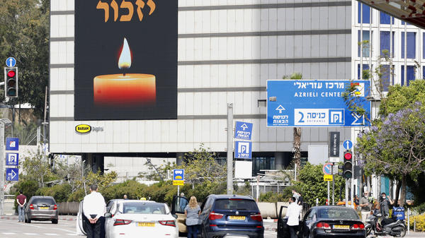 Israelis stand in silence on a street in Tel Aviv on Tuesday as sirens wailed across Israel for two minutes marking the annual day of remembrance for the 6 million Jewish victims of the Holocaust.