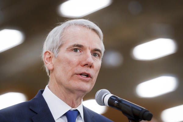 In this April 16, 2018 file photo, Sen. Rob Portman, R-Ohio, speaks during a news conference at a Kroger supermarket as the company announces new associate benefits attributed to the Tax Cuts and Jobs Act, in Cincinnati.