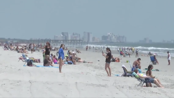 People descended upon Garden City's beach in South Carolina Tuesday, within minutes of an executive order taking effect that allows beaches to reopen if local leaders allow it. Other nearby beaches remain closed.