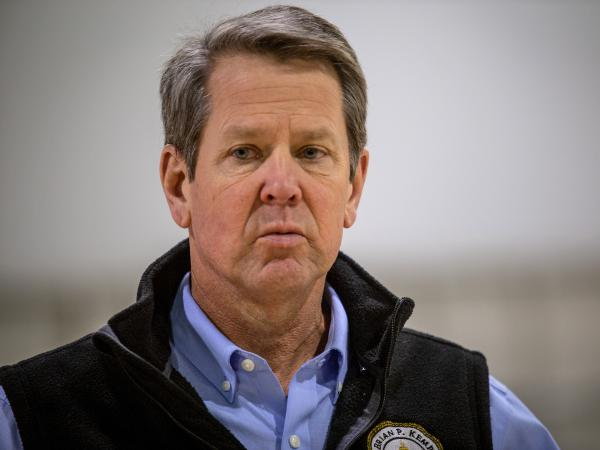 Georgia Gov. Brian Kemp, pictured on April 16, insists he is moving forward with plans to allow some nonessential businesses to open their doors to the public. The plan has come under intense criticism.