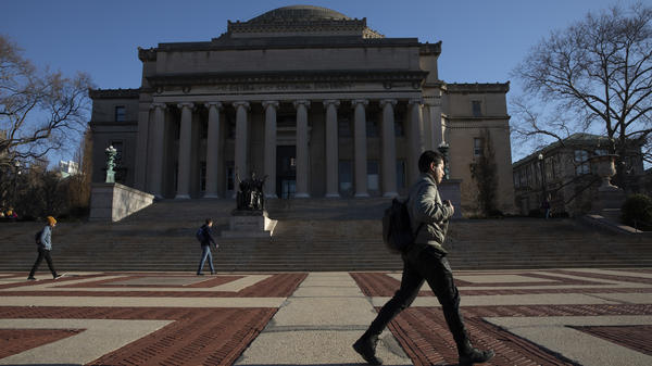 A man walks past Low Library on the Columbia University campus in New York City on March 9.