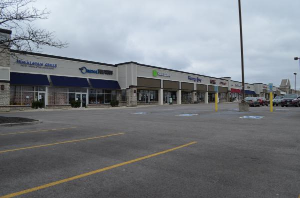 The parking lot at a shopping center in Gahanna east of Columbus has been nearly empty since the stay-at-home order on March 23.