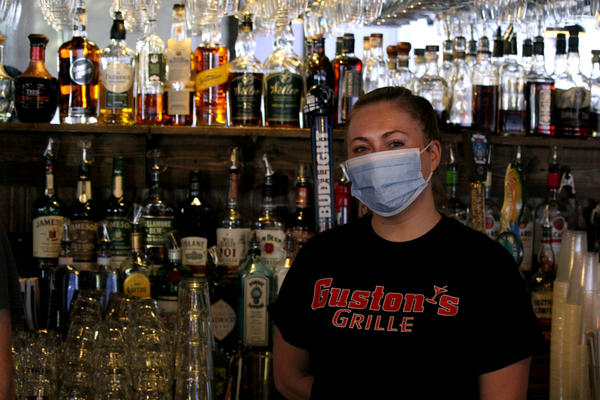 Ashley Mackay bartends at Guston's Bar and Grille in Woodstock. She's relieved the place is open for indoor dining again.