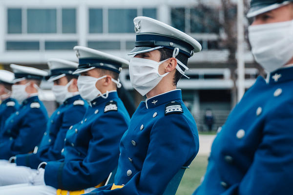 Air Force cadets sit 8 feet apart from each other during their graduation ceremony in Colorado Springs, Colo. Spectators were not allowed, and cadets didn't march on stage to receive their diplomas.